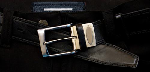 Silver buckle and belt in black hide leather